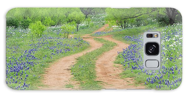 A Dirt Road Lined By Blue Bonnets Of Texas Galaxy Case
