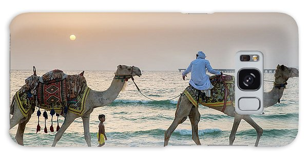 A Little Boy Stares In Amazement At A Camel Riding On Marina Beach In Dubai, United Arab Emirates Galaxy Case