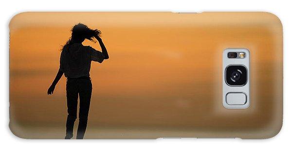 A Slim Woman Walking At Sunset Galaxy Case