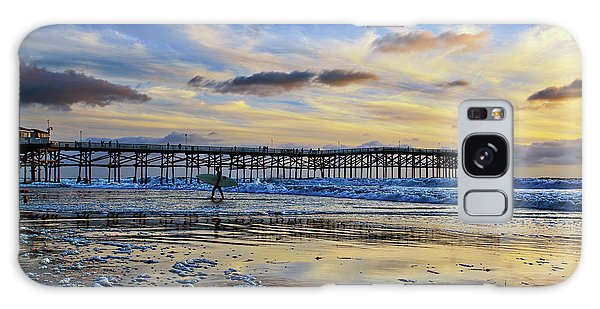 A Surfer Heads Home Under A Cloudy Sunset At Crystal Pier Galaxy Case