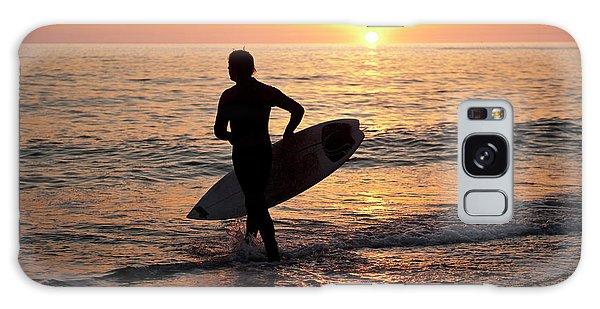 A Young Man Surfing At Sunset Off Aberystwyth Beach, Wales Uk Galaxy Case