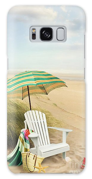 Galaxy Case featuring the photograph Adirondack Chair And Umbrella By The Seaside by Sandra Cunningham