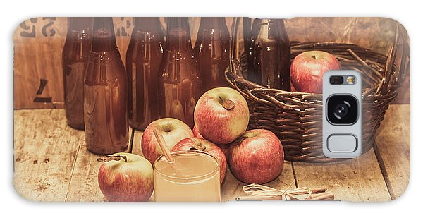 Indoors Galaxy Case - Apples Cider By Wicker Basket On Wooden Table by Jorgo Photography - Wall Art Gallery
