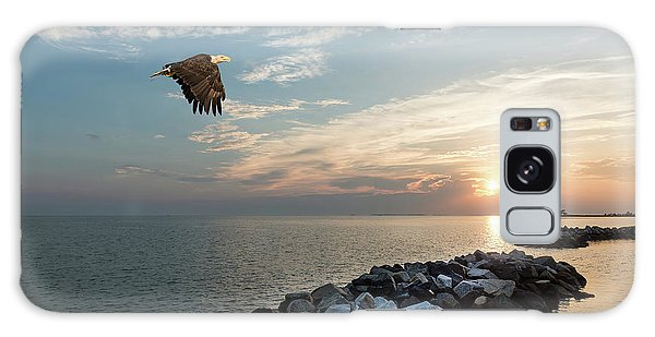 Bald Eagle Flying Over A Jetty At Sunset Galaxy Case