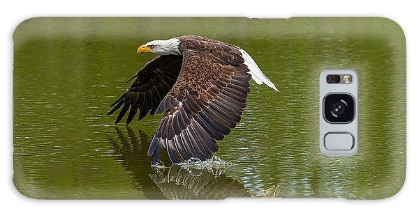 Bald Eagle In Low Flight Over A Lake Galaxy Case