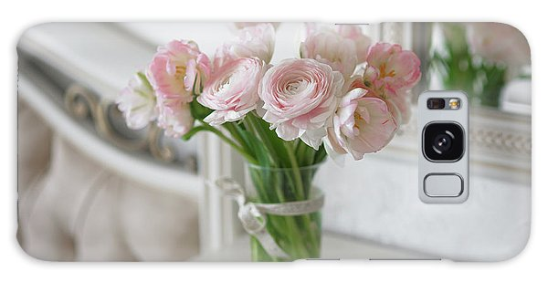 Bouquet Of Delicate Ranunculus And Tulips In Interior Galaxy Case