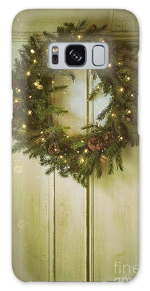 Galaxy Case featuring the photograph Christmas Wreath With Lights On Vintage Door by Sandra Cunningham
