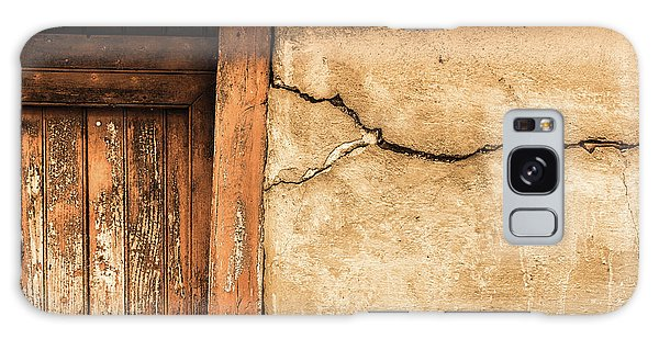 Cracked Lime Stone Wall And Detail Of An Old Wooden Door Galaxy Case by Semmick Photo