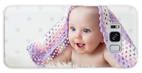 Cute Baby Laughing While Lying Under A Woollen Blanket. Galaxy Case