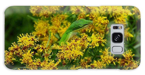 Green Anole Hiding In Golden Rod Galaxy Case