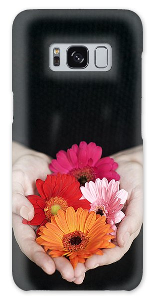 Hands Holding Colorful Gerbera Daisies  Galaxy Case