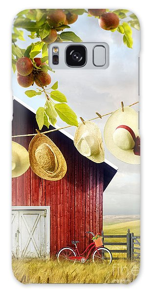 Galaxy Case featuring the photograph Large Red Barn With Hats On Clothesline In Field Of Wheat by Sandra Cunningham