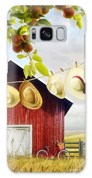 Large Red Barn With Hats On Clothesline In Field Of Wheat Galaxy Case