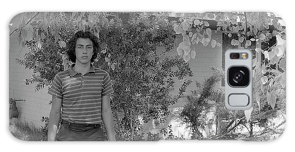 Man In Front Of Cinder-block Home, 1973 Galaxy Case