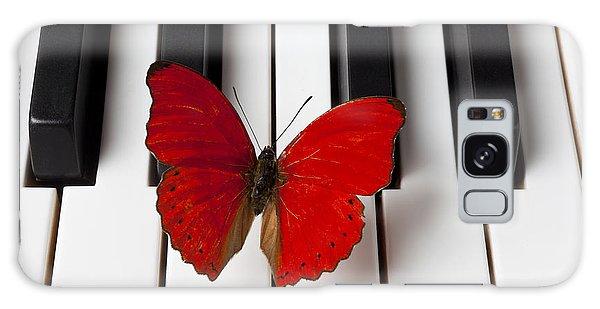Red Butterfly On Piano Keys Galaxy Case