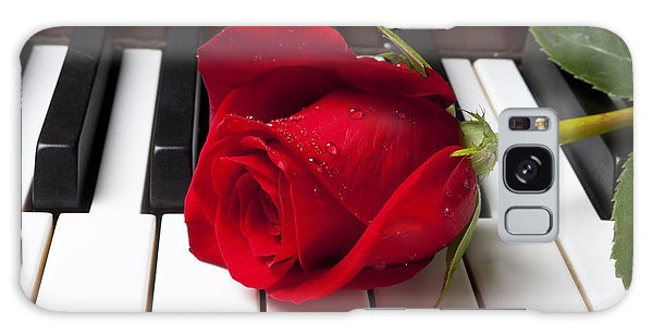 Horizontal Galaxy Case - Red Rose On Piano Keys by Garry Gay