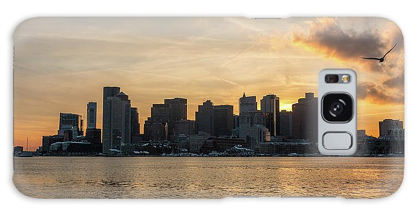 Seagull Flying At Sunset With The Skyline Of Boston On The Backg Galaxy Case