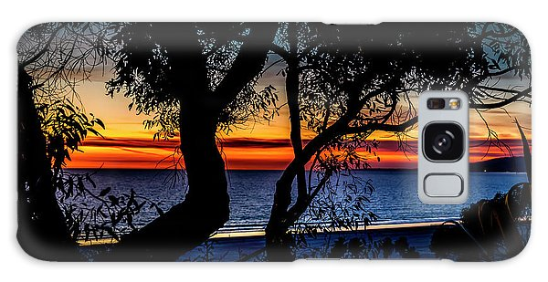 Silhouettes Over Blue Water Galaxy Case