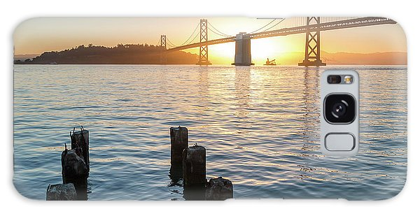 Six Pillars Sticking Out The Water With Bay Bridge In The Backgr Galaxy Case