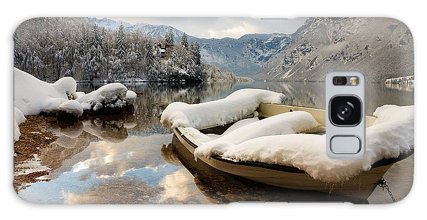 Snow Covered Boat On Lake Bohinj In Winter Galaxy Case