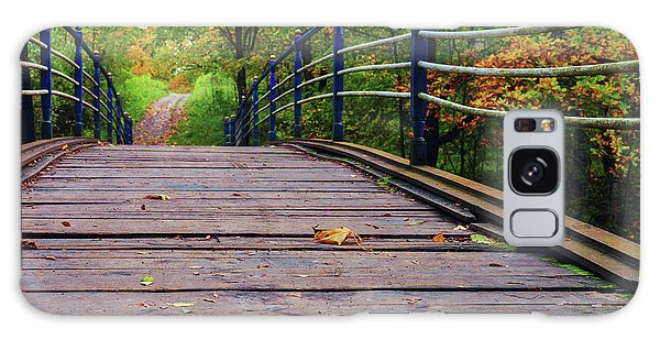 the old bridge over the river invites for a leisurely stroll in the autumn Park Galaxy Case