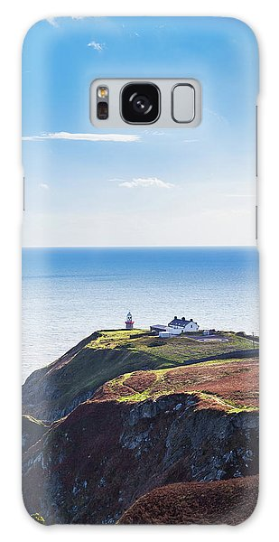 View Of The Trails On Howth Cliffs With The Lighthouse In Irelan Galaxy Case by Semmick Photo