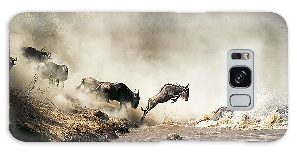 Wildlife Galaxy Case - Wildebeest Leaping In Mid-air Over Mara River by Susan Schmitz