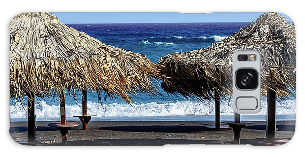 Wood Thatch Umbrellas On Black Sand Beach, Perissa Beach, In Santorini, Greece Galaxy Case