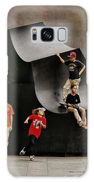 Young Skaters Around A Sculpture Galaxy Case