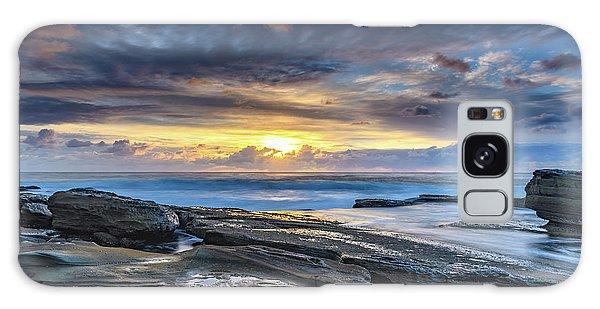 An Atmospheric Coastal Sunrise Galaxy Case