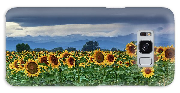 Galaxy Case featuring the photograph Sunflowers Under A Stormy Sky by John De Bord