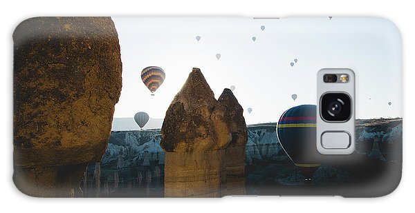 hot air balloons for tourists flying over rock formations at sunrise in the valley of Cappadocia. Galaxy Case