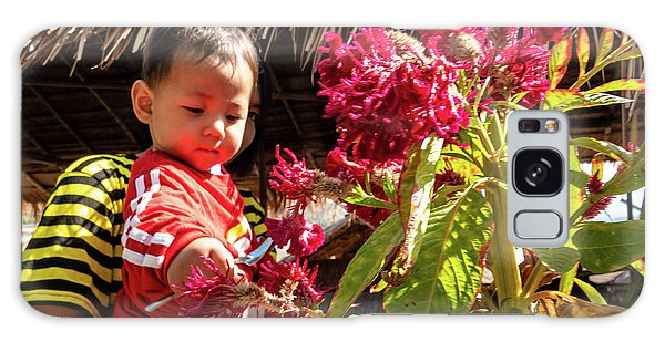 A Small Person With Reflected Flowers Galaxy Case