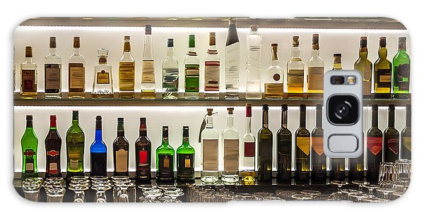 Bar Galaxy Case - Backlit Bottles And Glassware Behind A by Ken Felepchuk