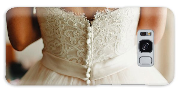 Bride Getting Ready, They Help Her By Buttoning The Buttons On The Back Of Her Dress. Galaxy Case