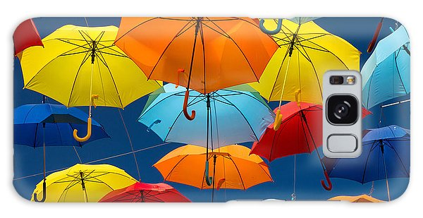 Weathered Galaxy Case - Lots Of Umbrellas Coloring The Sky In by Hugo Felix