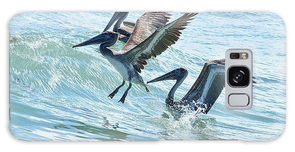 Wave Hopping Pelicans Galaxy Case