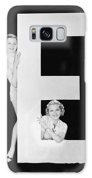 Hiding Galaxy Case - Women Posing With Huge Letter E by Everett Collection