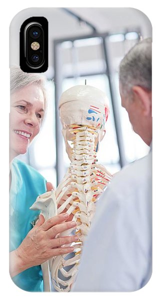 Female Chiropractor Showing Anatomical Model Phone Case by Science Photo Library