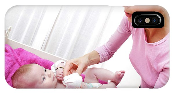 Dressing iPhone Case - Mother Dressing Her Baby by Aj Photo/science Photo Library