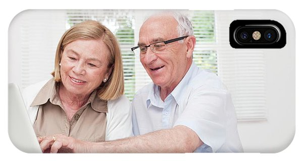 Technological iPhone Case - Senior Couple Using Laptop by Science Photo Library
