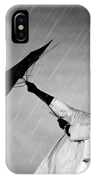 1950s Woman In Rain Coat Trying To Use IPhone Case