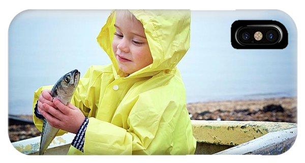 Boy Wearing Raincoat Holding A Mackerel IPhone Case