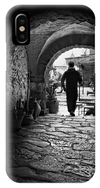 IPhone Case featuring the photograph Man In An Archway / Hammamet by Barry O Carroll
