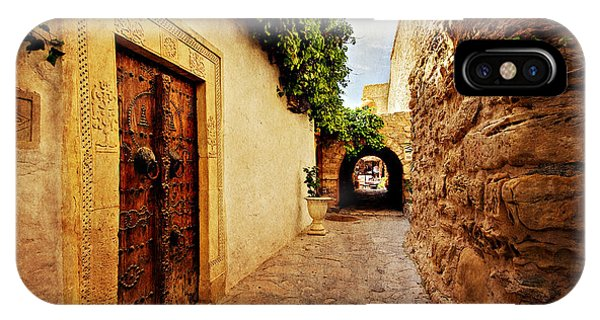 IPhone Case featuring the photograph Narrow Street In Souk / Hammamet by Barry O Carroll