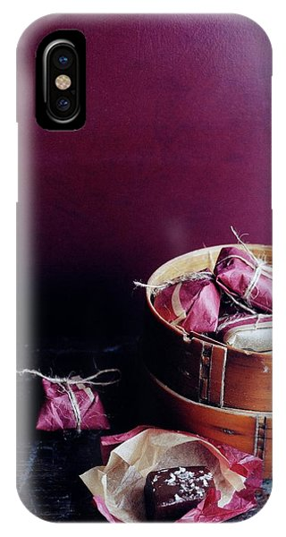 A Bamboo Steamer With Paper Packages IPhone Case