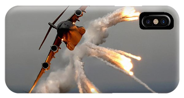 IPhone Case featuring the photograph A C-17 Globemaster IIi Releases Flares by Stocktrek Images