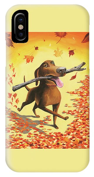 A Dog Carries A Stick Through Fall Leaves IPhone Case