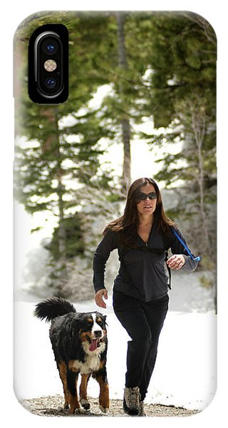 Bernese Mountain Dog iPhone Case - A Female Running With Her Dog by Jared McMillen