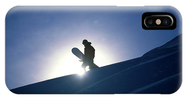 It Professional iPhone Case - A Female Snowboarder Hiking by Corey Rich